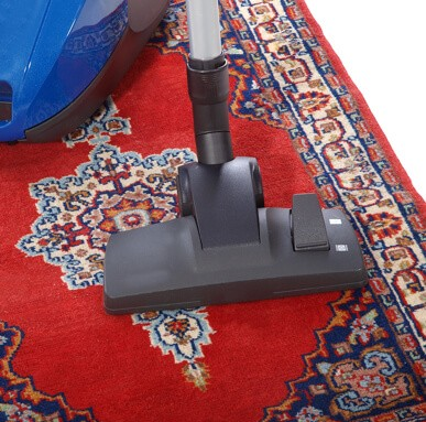 Rug cleaning by vaccum cleaner | Birons Flooring Inc